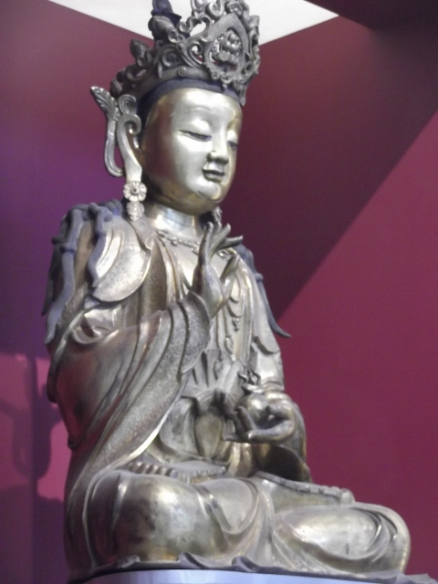 Huge Buddha sitting, right hand raised, eyes closed