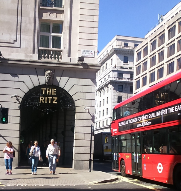 The Ritz hotal and a red London bus in the same shot.