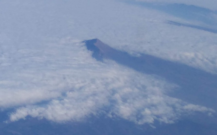 The tip of Mount Olympus showing through the clouds - taken from the aeroplane