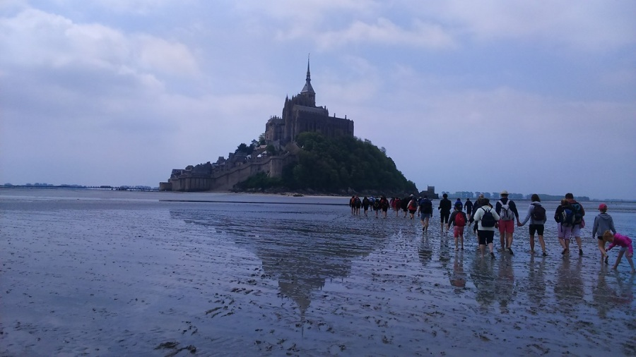 walking across the sands to mont saint michel