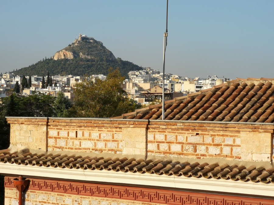 The peak of Lycabettus mountain with city in front