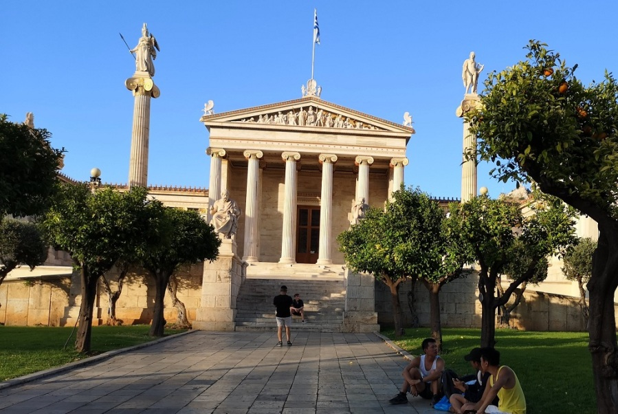 Classical Greek architecture with colums, pillars, statues and Greek flag flying