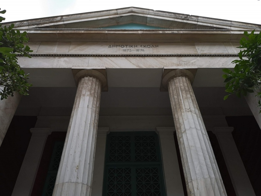 Classical Greek facade of school with columns and triangular roof, Athens