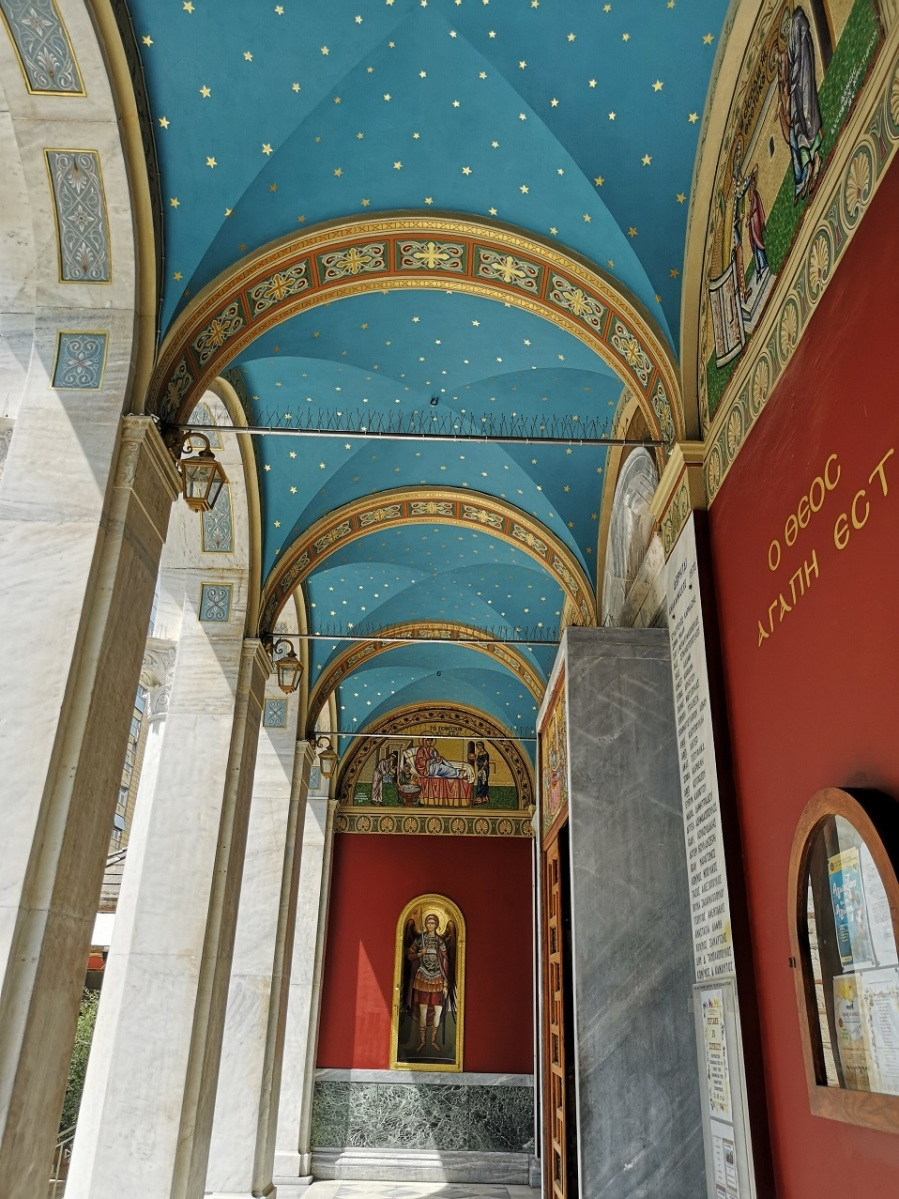 Blue painted roof with golden stars and red walls with religious paintings