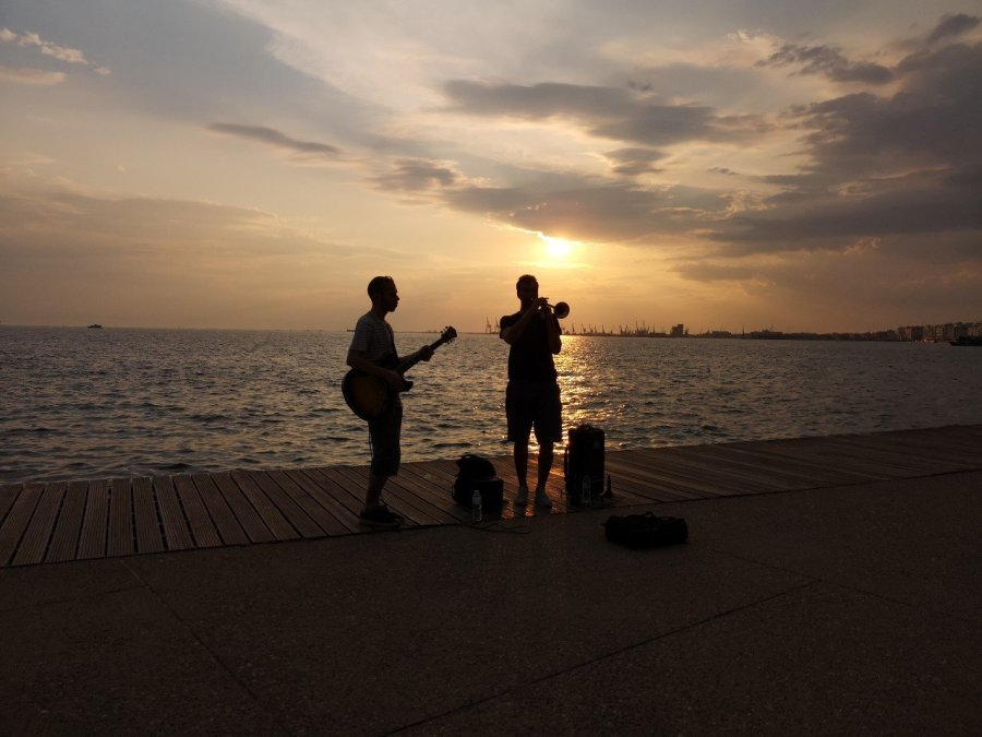 Musicians against setting sun