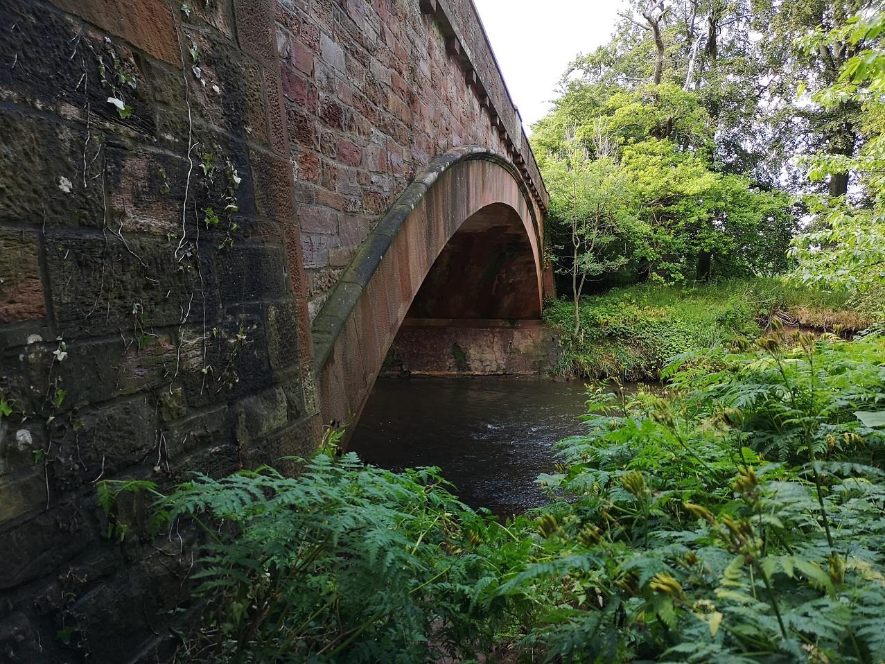 River flowing under bridge