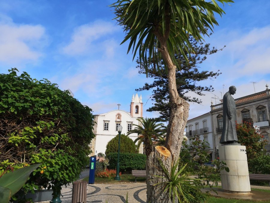 Church of our Lafy of Learning or Saint Paul, in leafy square with statue, Tavira, Portugal