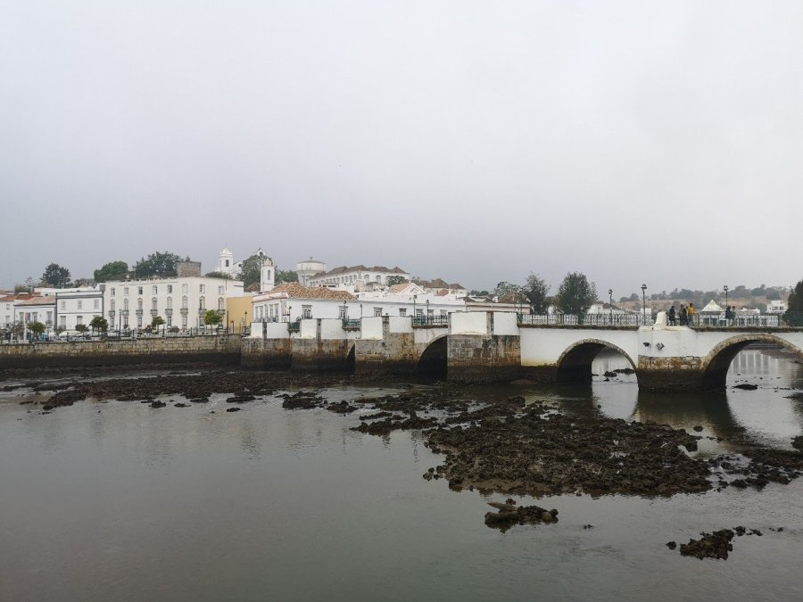 Town buildings of Tavira with Roman Bridge (Ponte Romana) across the river Gilao