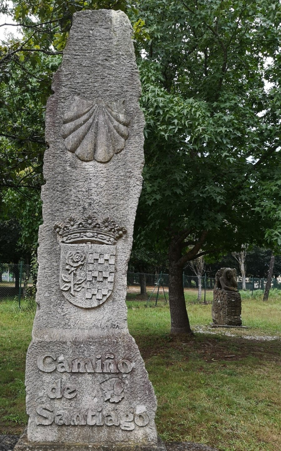 coat of arms camino shell stone marker