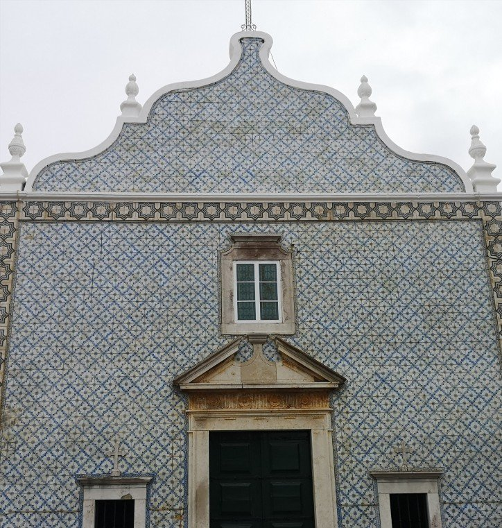 Decorated exterior of building with blue and white tiles in Tavira, Poetugal