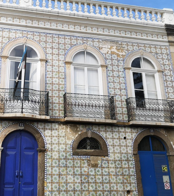 Building in Tavira showing the blue and white decoration, balustrades and tiled exterior, Portugal